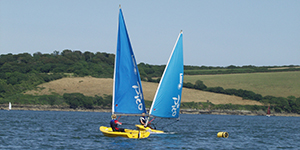 beginner racing at Mylor Sailing School Falmouth Cornwall