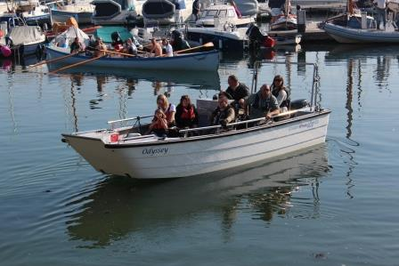 A group of people on an Accessible wheelchair friendly powerboat at Mylor Sailing School near Falmouth, Cornwall