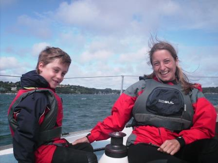 Mother and son sailing on a boat in Mylor Cornwall