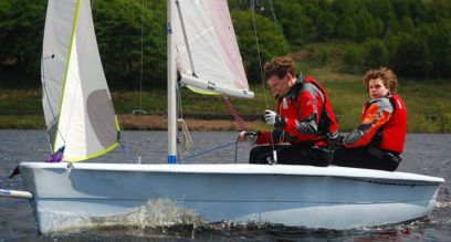 two men sailing a dinghy at Mylor Sailing School Falmouth Cornwall