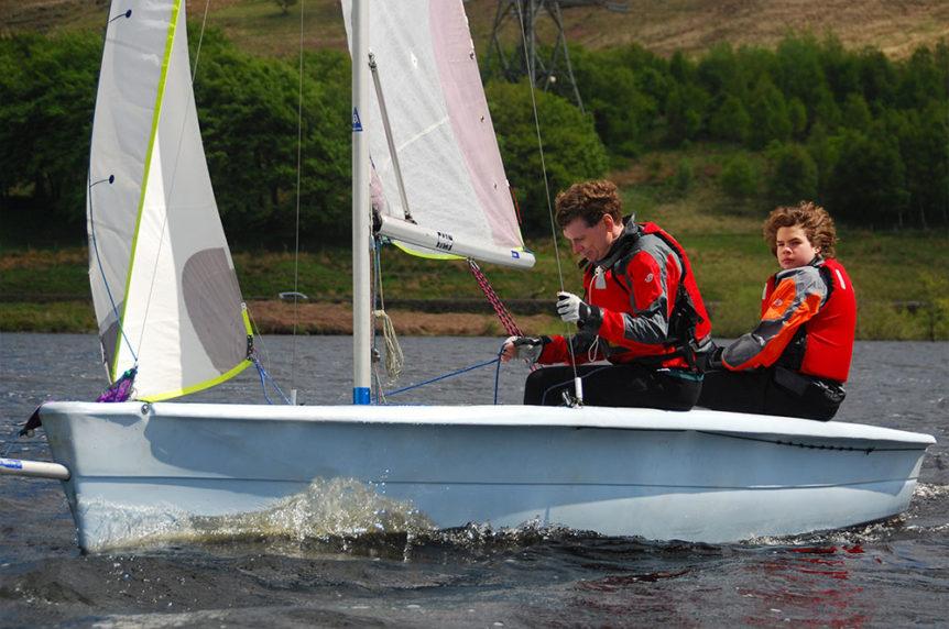 two men sailing a dinghy at Mylor Sailing School Falmouth Cornwall