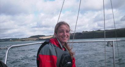 Ladies sailing on a small keelboat at mylor sailing school near falmouth