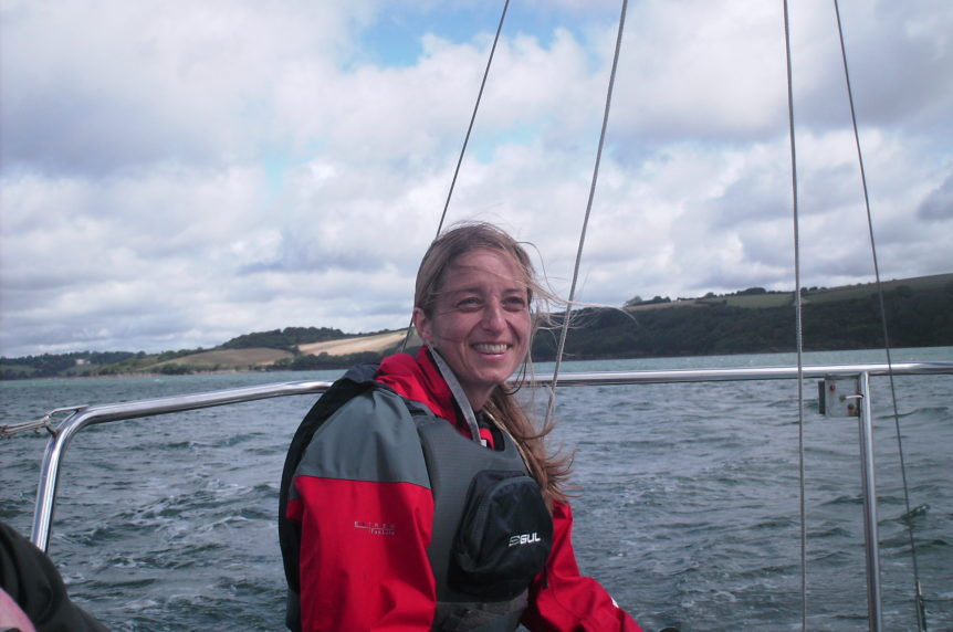 Ladies sailing on a small keelboat at mylor sailing school near falmouth