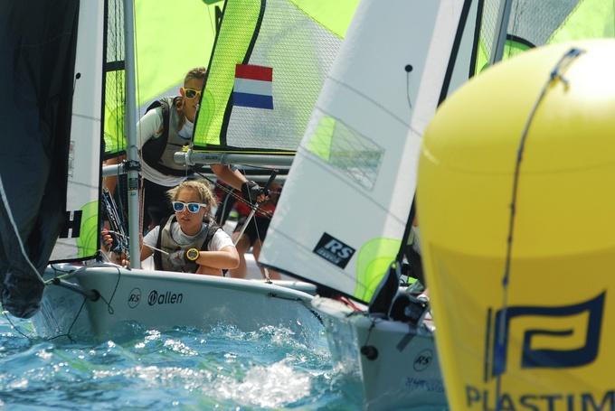 A few sailing dinghies racing close together at Mylor Sailing School Falmouth