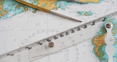 Navigation chart with dividers and ruler at Mylor Sailing School Cornwall