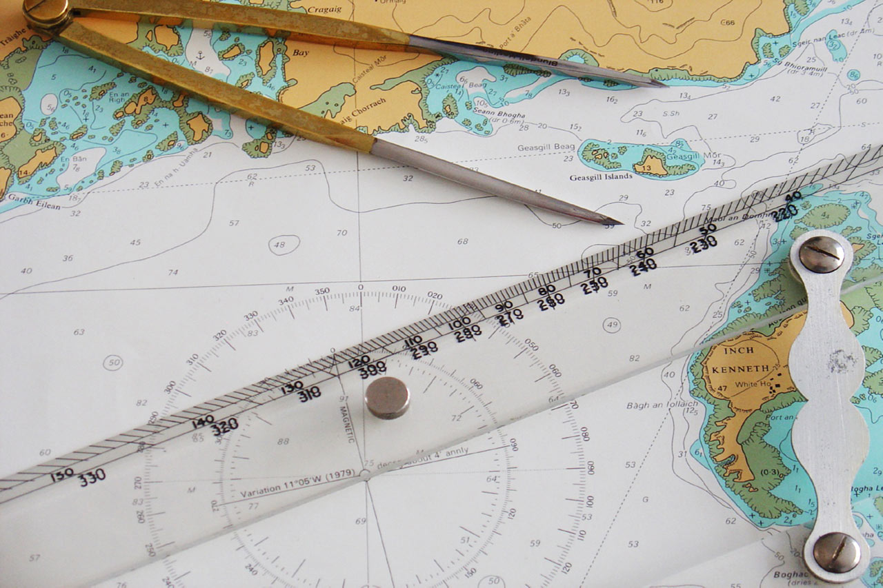 Navigation chart with dividers and ruler at Mylor Sailing School Cornwall