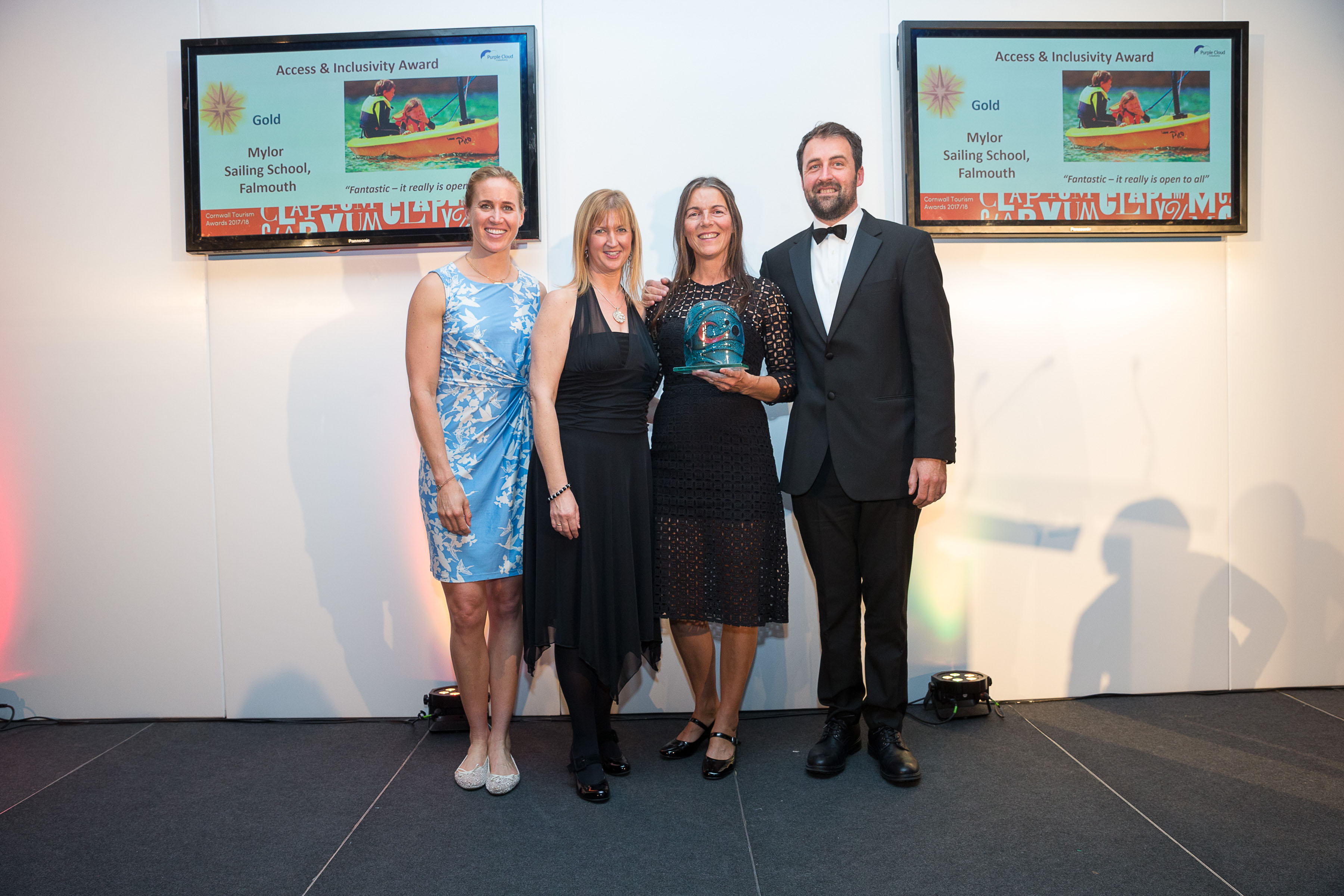 Helen Glover with owners of Mylor Sailing school collecting their GOLD award at the Cornwall Tourism Awards in November 2017