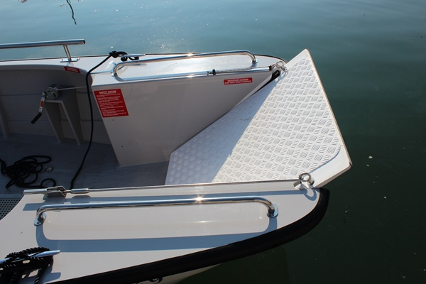 Front of wheelchair friendly powerboat, door able to lower down at Mylor Sailing School Falmouth Cornwall