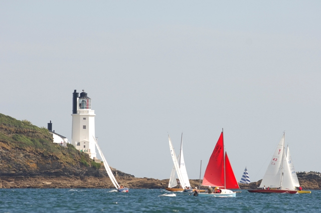 Light house and a few boats sailing in the Carrick Roads near Mylor Sailing School, Falmouth Cornwall