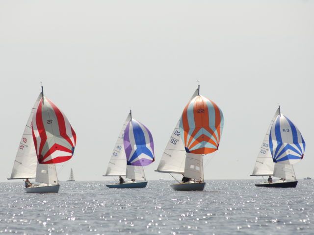 Ajax boats sailing at Falmouth with their colourful spinnaker sails, Mylor Sailing School Cornwall