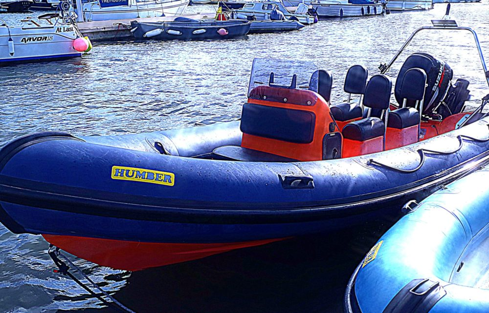 Blue and orange Humber RIB motorboat at Mylor Sailing School Falmouth Cornwall