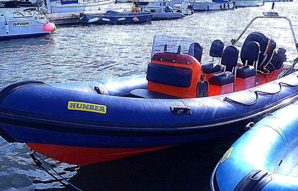 Blue and orange Humber RIB motorboat at Mylor Sailing School Falmouth Cornwall
