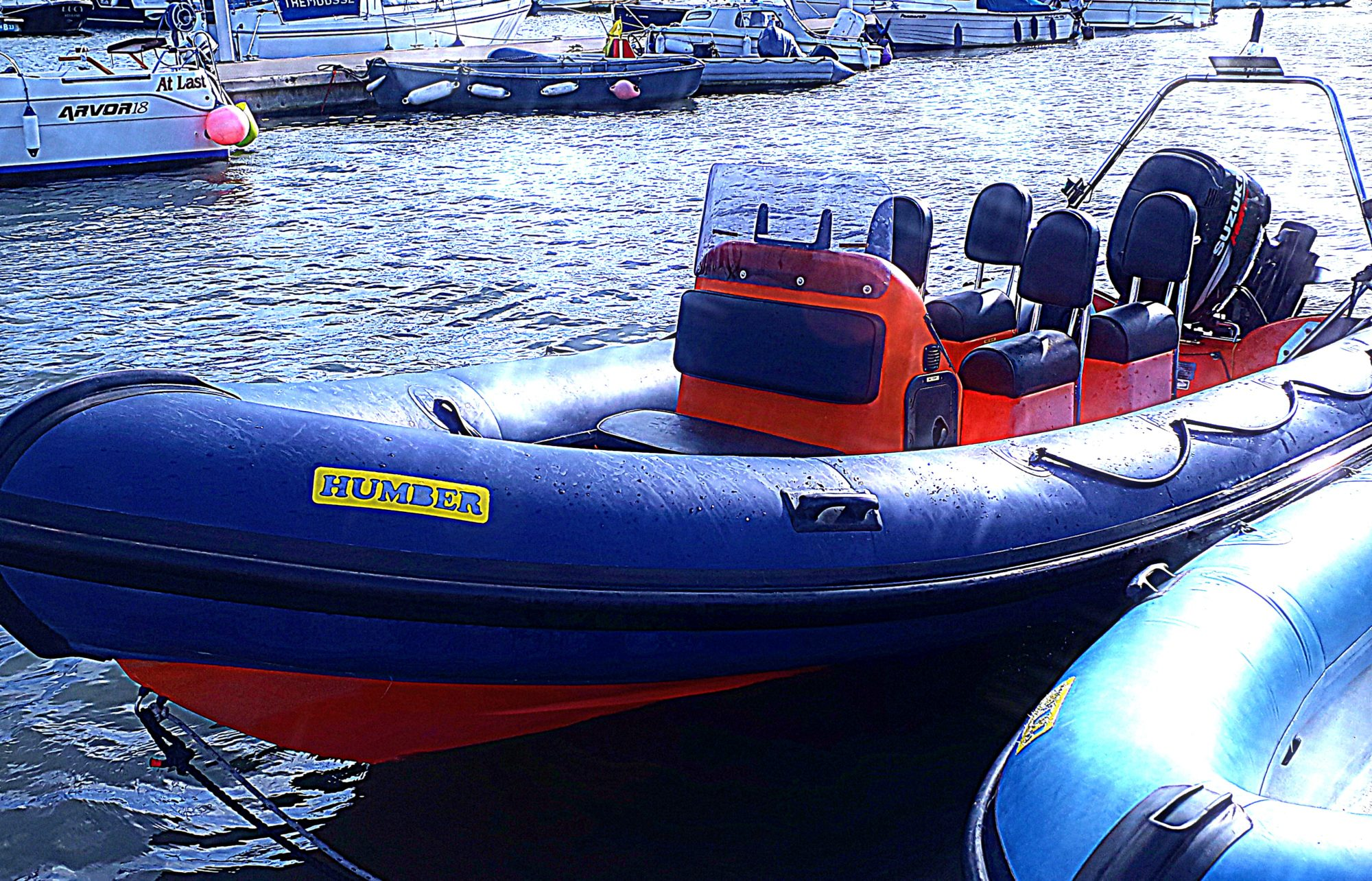 Blue and orange Humber RIB with 4 seats in the water at Mylor Sailing School Falmouth Cornwall