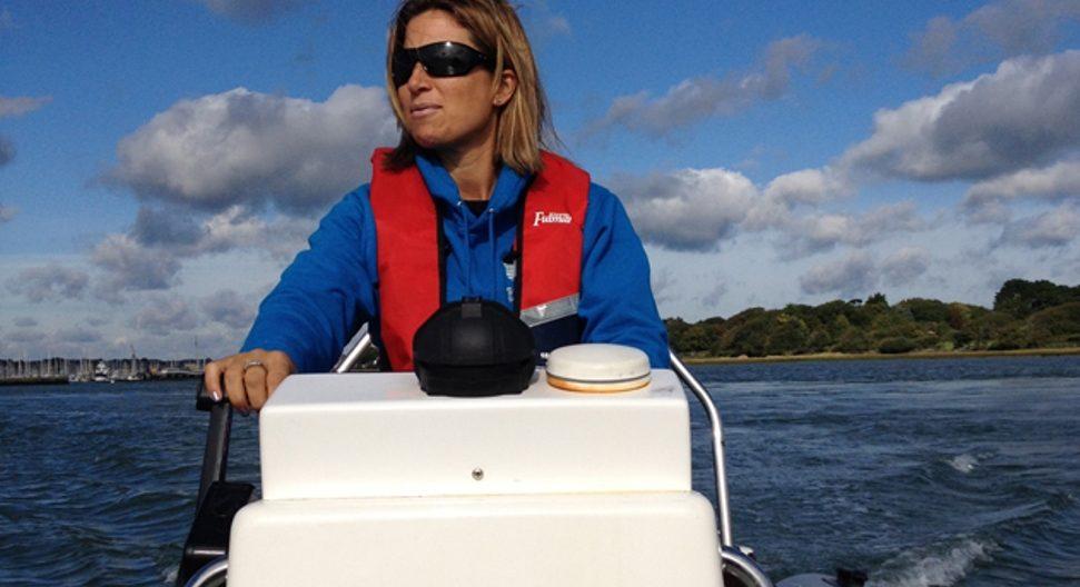 Lady driving a motorboat at Mylor Sailing School Falmouth Cornwall