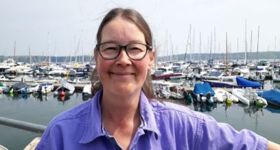 Shorebased trainer lady with glasses and brown hair smiling Suzanna Allin trainer at Mylor Sailing School