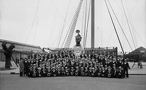 Crew of HMS Ganges standing in a group for a photo Fal Estuary Cornwall