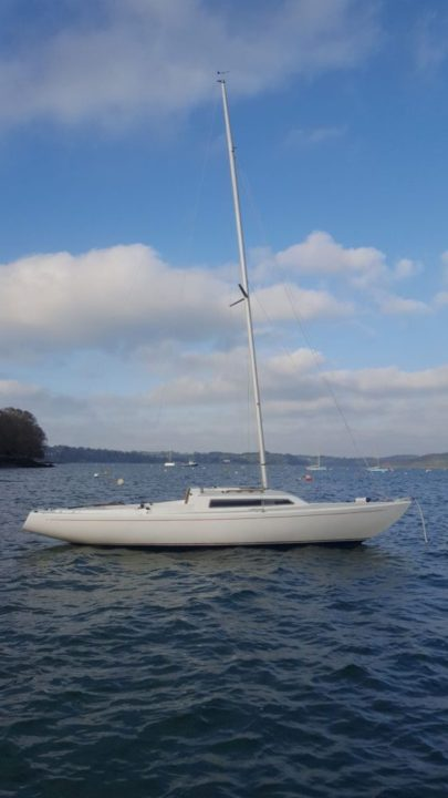White keelboat on swing mooring at Mylor Sailing School Falmouth Cornwall