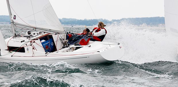 H Boat sailing with 2 people in windy conditions at Mylor Sailing School Falmouth Cornwall