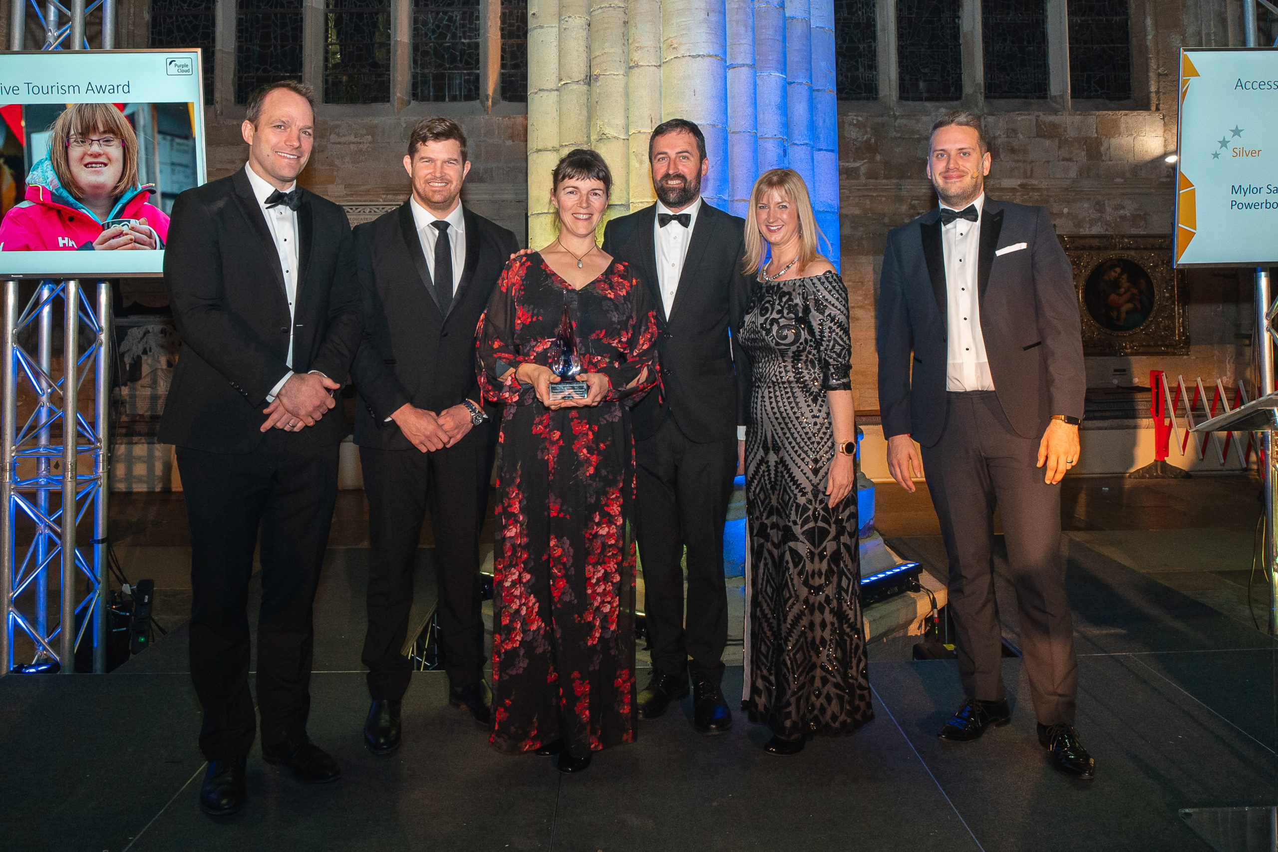 Six of the people in Exeter Cathedral accepting an award at the ceremony
